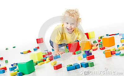 Child happy playing blocks over white