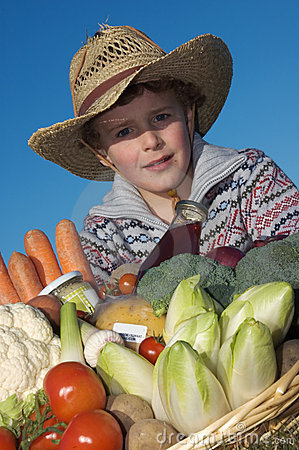 Child with harvest vegetables