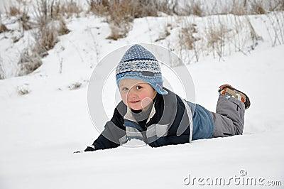 Child having fun on snow