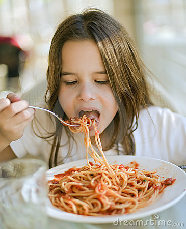 Child having spaghetti