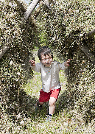 Child in hay stack