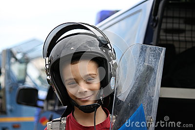Child with helmet and shield
