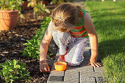 Child helping in garden