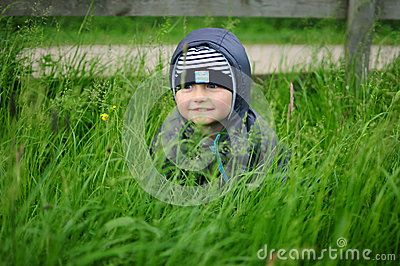 Child hiding in the grass