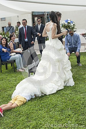 Free Child Hiding Under The Bride`s Dress Stock Photos - 153645243