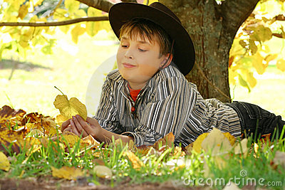 Child holding autumn leaves