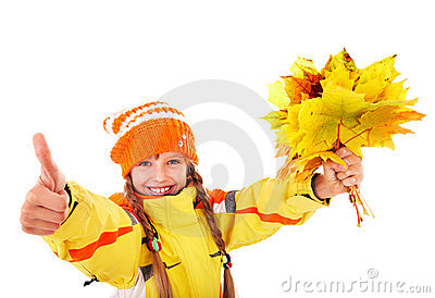 Child in holding autumn leaves thumb up.
