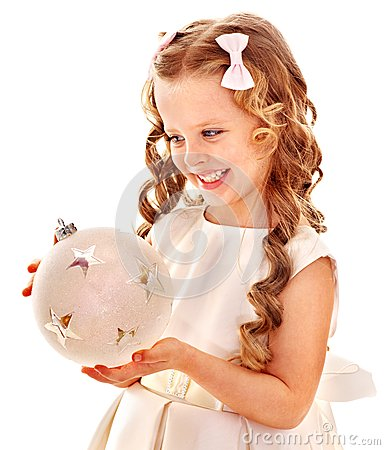 Child holding big white Christmas ball.