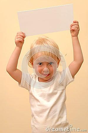 Child holding blank placard