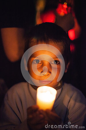 Child holding candle