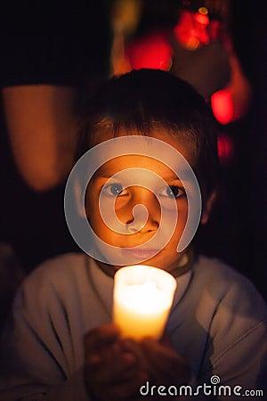 Child holding candle