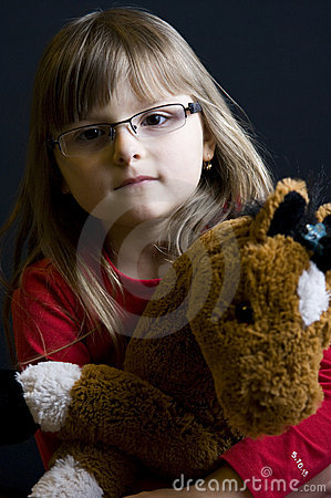 Child holding cuddly toy