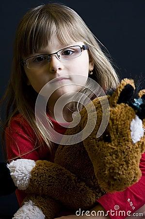 Child holding cuddly toy