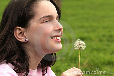 Child Holding Dandilion Looking Up