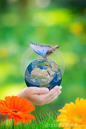 Free Child Holding Earth Planet With Blue Butterfly In Hands Royalty Free Stock Photo - 51082755