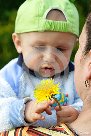 Child holding a flower