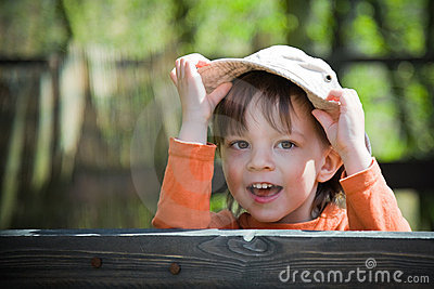 Child holding his hat