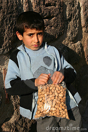 A Child Holding His Peanuts