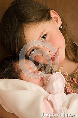 Child holding infant