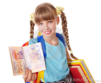 Child holding international passport and book.