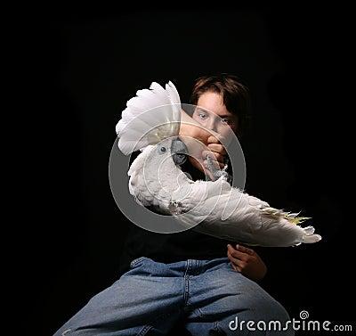 Child Holding Playful Bird