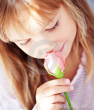 Child holding rose