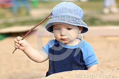 Child holding stick