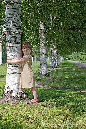 Child holding tree