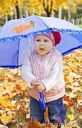 Child holding umbrella