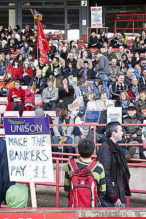 Child holding a UNISON placards saying Editorial Stock Photo