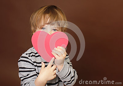 Child holding Valentine s Day Heart Sign