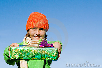 Child holding wrapped gifts