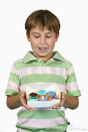 Child holding yummy cupcakes