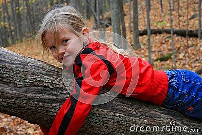 Child hugging a tree.