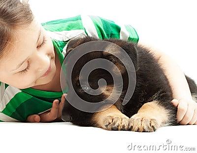 Child   hugs puppy