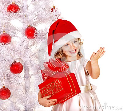 Free Child In Santa Hat With Gift Box Near White Christmas Tree. Stock Photography - 35353652