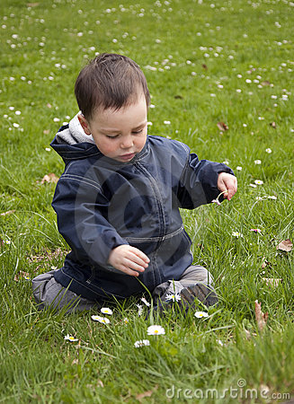 Free Child In Spring Grass Royalty Free Stock Photos - 13923408