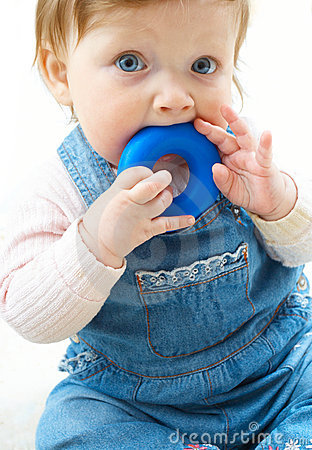 Child at jeans suit with toy
