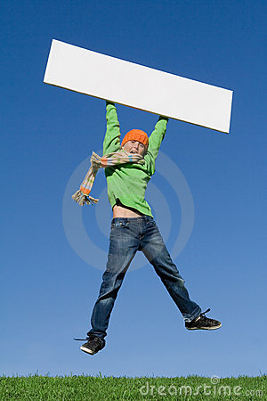 Child jumping with blank sign