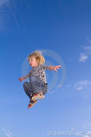 Child jumping  sky