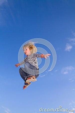 Child jumping  sky