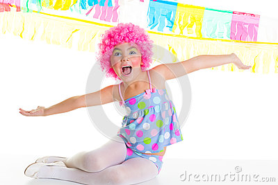 Child kid girl with party clown pink wig funny expression