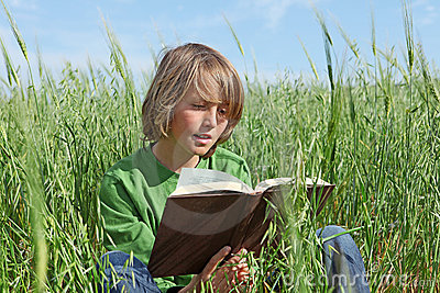 Child or kid reading book