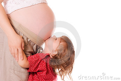 Child kissing pregnant mother