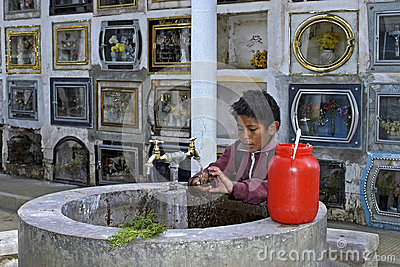 Child labor on cemetery of the city Cochabamba Editorial Stock Photo