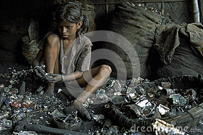 Child labor in recycling of batteries, Bangladesh Editorial Stock Photo