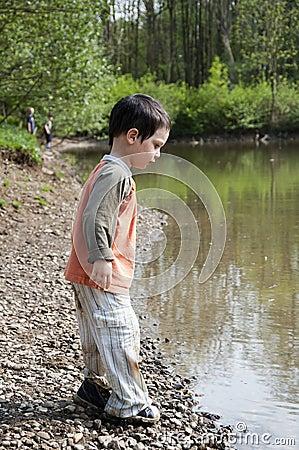 Child by lake