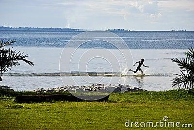 Child on Lake Victoria Editorial Stock Image