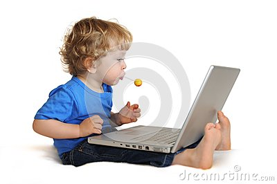 Child with laptop and lollipop
