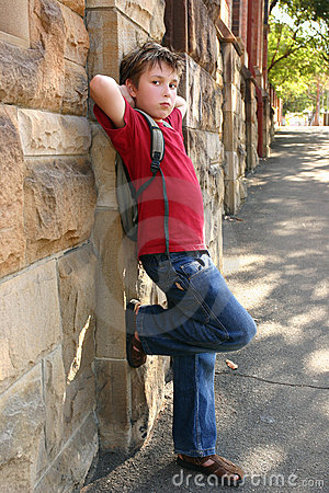 Child leaning against wall
